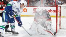 Mike Condon gets snowed as he makes a save against Bo Horvat during Thursday's game. (Francois Laplante/FreestylePhoto/Getty Images)