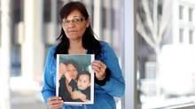 Vivian Tuccaro of Alberta holds up a photo of her daughter Amber and grandson Jacob during a break at a gathering of victims' families of murdered and missing aboriginal women February 26, 2015 in Ottawa. Her daughter Amber was murdered. (Dave Chan For The Globe and Mail)