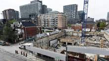 Construction of a condominium on Queen St. West in Toronto. (Fred Lum/The Globe and Mail)