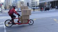 Bike couriers earn about $20,000 to $30,000 a year in commissions. But that's before expenses such as buying their own bikes, tires and other maintenance. (FRED LUM/THE GLOBE AND MAIL)