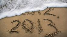 New year 2013 written on the sand while 2012 gets washed away by the water. (KaeArt/Getty Images/iStockphoto)