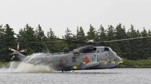 A Canadian forces Sea King helicopter flown by Britain's Prince William lands on Dalvay lake in a routine called 'waterbirding' in Dalvay-by-the-sea, July 4, 2011 (Phil Noble/Reuters)