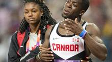 Canada's Justyn Warner is comforted by his fiance Nikki Holder as he reacts to his team's disqualification in the 4x100-metre relay at the 2012 Summer Olympics in London on Saturday, August 11, 2012. (Ryan Remiorz/THE CANADIAN PRESS)