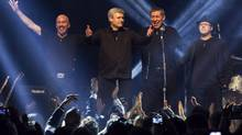 Phil Nolan (far right) who plays drums in the band that often accompanies Prime Minister Stephen Harper, is facing multiple charges of sexual assault and sexual interference. Harper and his band Herringbone receive applause after performing in Toronto on Sunday, December 1, 2013. (Chris Young/THE CANADIAN PRESS)