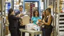Dental lawyer Michael Carabash, second from left, packs boxes with 1000 Smiles Project trip volunteers : forthcoming dental lawyer Karen Ergus (R), dentist Dr. Ayla Cintosun (2nd R), volunteer Amber Cintosun (C), and dental lawyer Ljubica Durlovska (L) at K-Dental, a dental supplies and equipment warehouse in Toronto, Tuesday June 9, 2015. Carabash is organizing an annual trip by a group of dentists to do free work in a poor neighbourhood in Jamaica . (Mark Blinch For the Globe and Mail)