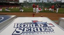 Boston Red Sox players stretch before a workout at Fenway Park, Tuesday, Oct. 22, 2013, in Boston. (Associated Press)