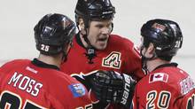 David Moss #25, Olli Jokinen #13 and Curtis Glencross #20 of the Calgary Flames celebrate a goal against the Phoenix Coyotes in third period NHL preseason action on September 29, 2011 at the Scotiabank Saddledome in Calgary, Alberta, Canada. (Photo by Mike Ridewood/Getty Images) (Mike Ridewood/Getty Images)