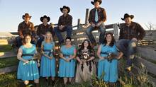 Chelsea and Daniel Seitz pose with their wedding party on Sept. 28, 2013, in Pierson, Man. The couple met through the dating site FarmersOnly. (HANDOUT/CHRIS JONES/THE CANADIAN PRESS)
