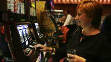 A guest tries out the slot machines at Slots at Ajax Downs in this photo from 2006. (Jim Ross/Handout/OLGC)