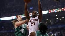 Toronto Raptors forward Rudy Gay (22) dunks in between Boston Celtics forward Kelly Olynyk (41) and forward Gerald Wallace (45) during the first half at the Air Canada Centre. (John E. Sokolowski/USA Today Sports)