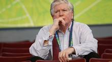 Brian Burke watches a Team Canada practice at the Vancouver Olympics. (Peter Power/The Globe and Mail)