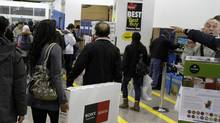 Shoppers walk inside of the Best Buy store in downtown Toronto. (Fernando Morales/Fernando Morales/The Globe and Mail)