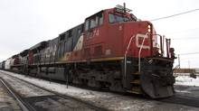 A CN train passes by Dorval station in Montreal in this file photo. (Christinne Muschi For The Globe and Mail)