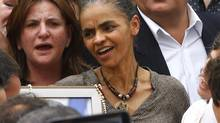 Brazilian politician Marina Silva, centre, former minister of the environment under the government of Luiz Inacio Lula da Silva, attends the wake for late presidential candidate Eduardo Campos, at the Pernambuco Government Palace in Recife, August 17, 2014. (RICARDO MORAES/REUTERS)