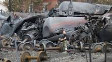 A police officer looks on near the site of the train wreckage in Lac Megantic, in this July 9, 2013 file photo. (MATHIEU BELANGER/REUTERS)