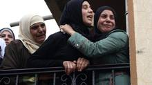 The wife of Lebanese soldier Ali al-Sayyed, who was beheaded by Islamic State militants in Arsal, mourns during his funeral in his hometown of Fnideq in Akkar September 3, 2014. Islamic State militants beheaded al-Sayyed, a Lebanese soldier who was one of 19 captured by hardline Syrian Islamists when they seized the Lebanese border town for a few days last month, a video posted on social media showed on Saturday. (STRINGER/REUTERS)