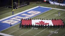 The Canadian flag is carried over the Buffalo Bills endzone before the Bills play the Atlanta Falcons in NFL action in Toronto (Mark Blinch/The Canadian Press)