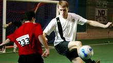 Globe and Mail columnist Derek DeCloet (right) gets a leg up for the ball as he tries to defend the goal during tryouts for the Toronto Football Club at The Soccer Centre in Vaughan, Ont., December 18, 2006. (Yvonne Berg/Yvonne Berg for The Globe and Mail)