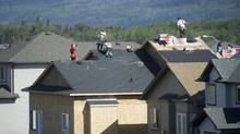 Workers build homes in a suburb of Fort McMurray, Alta., in this photo from 2010. The Wood Buffalo census agglomeration, which includes Fort McMurray, generates only 2.2 per cent of its total income from government sources. (Kevin Van Paassen/The Globe and Mail)