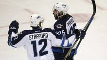 Winnipeg Jets center Mathieu Perreault, right, celebrates his goal with right wing Drew Stafford, against the Colorado Avalanche during the third period of an NHL hockey game Saturday, Feb. 6, 2016, in Denver. (David Zalubowski/AP)