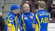 Alberta coach Kevin Martin, centre, talks with Darren Moulding, left, and his son Karrick Martin on Monday in St. John's. (Andrew Vaughan/THE CANADIAN PRESS)