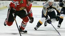 Nashville Predators' Ryan Suter, right, defends during the second period of an NHL hockey game Thursday, Oct. 12, 2006, in Chicago. (Jeff Roberson/The Associated Press)