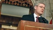 Canadian Prime Minister Stephen Harper speaks to the media at a press conference in the foyer of the House of Commons in Ottawa following the fall of his government in a no-confidence vote on March 25, 2011. (GEOFF ROBINS/Geoff Robins/AFP/Getty Images)
