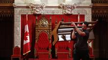 Preparing the Senate chamber for the Throne Speech. (CHRIS WATTIE/REUTERS)