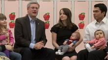 Conservative leader Stephen Harper talks with parents during a roundtable near Edmonton on Monday, March 28. (Adrian Wyld/Adrian wyld/The Canadian Press)