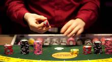 A croupier places gaming chips on a card table at Aspers Casino at Westfield Stratford City Mall in London, U.K. on Wednesday, Jan. 11, 2012. (Simon Dawson/Bloomberg/Simon Dawson/Bloomberg)