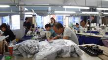 The Chinese garment industry has had a difficult start to the year: This month's HSBC flash PMI dipped to a four-year low this month, driven down in part by slowing export growth of just 7 per cent year-on-year for January and February – half as fast as in December. (Yu Mei for The Globe and Mail)
