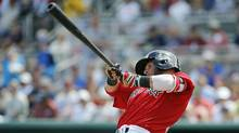 Boston Red Sox second baseman Dustin Pedroia (15) singles during the first inning against the Toronto Blue Jays at JetBlue Park on March 14, 2017. (Kim Klement/USA Today Sports)