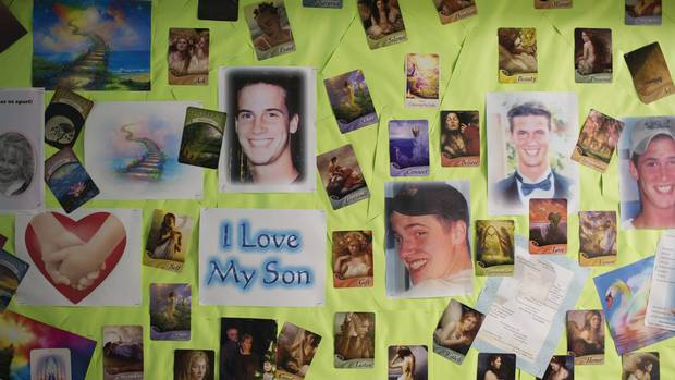 """Betty-Lou Kristy of Georgetown, Ont., who lost her son Pete to an overdose of prescription painkillers, has made a """"healing wall"""" in her basement where her son used to sleep."""