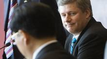 Canadian Prime Minister Stephen Harper looks towards China's President Hu Jintao prior to the first session of the Asia Pacific Economic Co-operation summit in Hanoi Vietnam on Nov. 18, 2006. (TOM HANSON/CP)