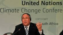 Xie Zhenhua, Vice-Chairman of the National Development and Reform Commission of China and head of Chinese delegation to the UN climate talks, speaks during a news conference in Durban on Dec. 5, 2011. (Alexander Joe/AFP/Getty Images/Alexander Joe/AFP/Getty Images)