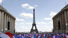 Supporters wave flags as they wait for Nicolas Sarkozy, to deliver his speech at Trocadero square during a campaign rally in front of the Eiffel Tower in Paris May 1, 2012. (GONZALO FUENTES/REUTERS/GONZALO FUENTES/REUTERS)