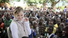 Madonna visits school children in Chorwe, Malawi on Wednesday, April 3, 2013. Her foundation, Raising Malawi, has built ten schools in partnership with BuildOn which are currently educating over 4,000 students per year. (Liz Rosenberg Media/AP)