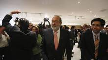 The family of Mexican businessman Carlos Slim has lost about 26 billion pesos ($2.05-billion) on paper in America Movil since Tuesday's close. (REUTERS)