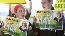 Young Green Party supporters hold signs during the kick-off of Elizabeth May's election campaign in Saanichton, near Victoria, on March 26, 2011. (DEDDEDA STEMLER/THE CANADIAN PRESS)