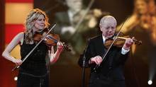 Nathalie MacMaster plays with her uncle Buddy MacMaster at the East Coast Music Award in Charlottetown Monday, Feb 27, 2006 file photo. Buddy MacMaster has died at age 89. (JACQUES BOISSINOT/THE CANADIAN PRESS)