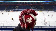 Dallas Ohl from Belleville, Ont., watches Canada take to the ice before playing against Germany in Ufa, Russia, on Boxing Day. (NATHAN DENETTE/THE CANADIAN PRESS)
