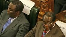 Zimbabwe's Prime Minister Morgan Tsvangirai, left, and President Robert Mugabe (DESMOND KWANDE)