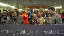 Delegates line up to vote as technical difficulties cause lengthy delays at the NDP leadership convention in Toronto on March 24, 2012.( (Kevin Van Paassen/Kevin Van Paassen/The Globe and Mail)
