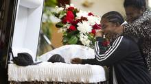 Mourners weep at the funeral for 15-year old Tyson Bailey in Toronto on Thursday. The teen at the Seventh-Day Adventist Church on Bentworth Ave. in Toronto on Jan. 31, 2013. Bailey was shot to death last week in the stairwell of an apartment building in Regent Park. (Peter Power/ The Globe and Mail) (Peter Power/Peter Power/The Globe and Mail)