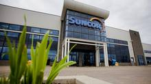The Suncor Energy Inc. offices stand in Fort McMurray, Alberta, Canada, on Wednesday, June 19, 2014. (Ben Nelms/Bloomberg)