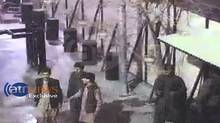 In this frame grab provided from a video by Ariana Television News, four attackers entering the first gate of the Serena hotel in Kabul, Afghanistan on Thursday, March 20. (Uncredit/AP)