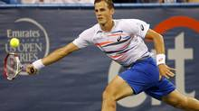Vasek Pospisil hits a forehand against Santiago Giraldo (not pictured) on day five of the Citi Open tennis tournament at the Fitzgerald Tennis Center in Washington on Aug. 1. (Geoff Burke/USA Today Sports)
