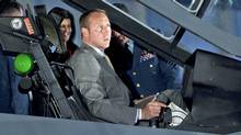 Defence Minister Peter MacKay checks out the cockpit of a F-35 Joint Strike Fighter mockup in Ottawa on July 16, 2010. (Adrian Wyld/THE CANADIAN PRESS)