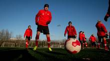 Canadian soccer captain Christine Sinclair (left) and teammates practice in Burnaby, B.C., Nov. 20. (DARRYL DYCK for The Globe and Mail)