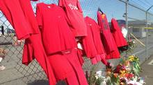 Shirts hang in memory of dead workers at the Nanaimo mill site on Thursday May 1, 2014. (Dirk Meissner/THE CANADIAN PRESS)